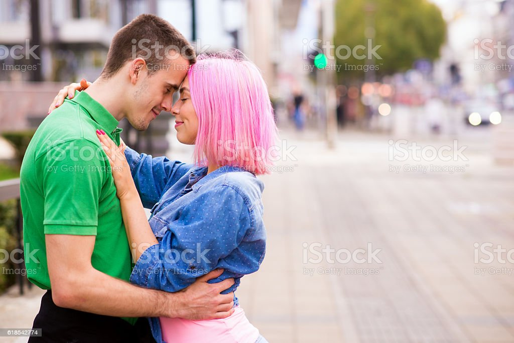 Young beautiful couple lovers hugging outside during the autumn stock photo