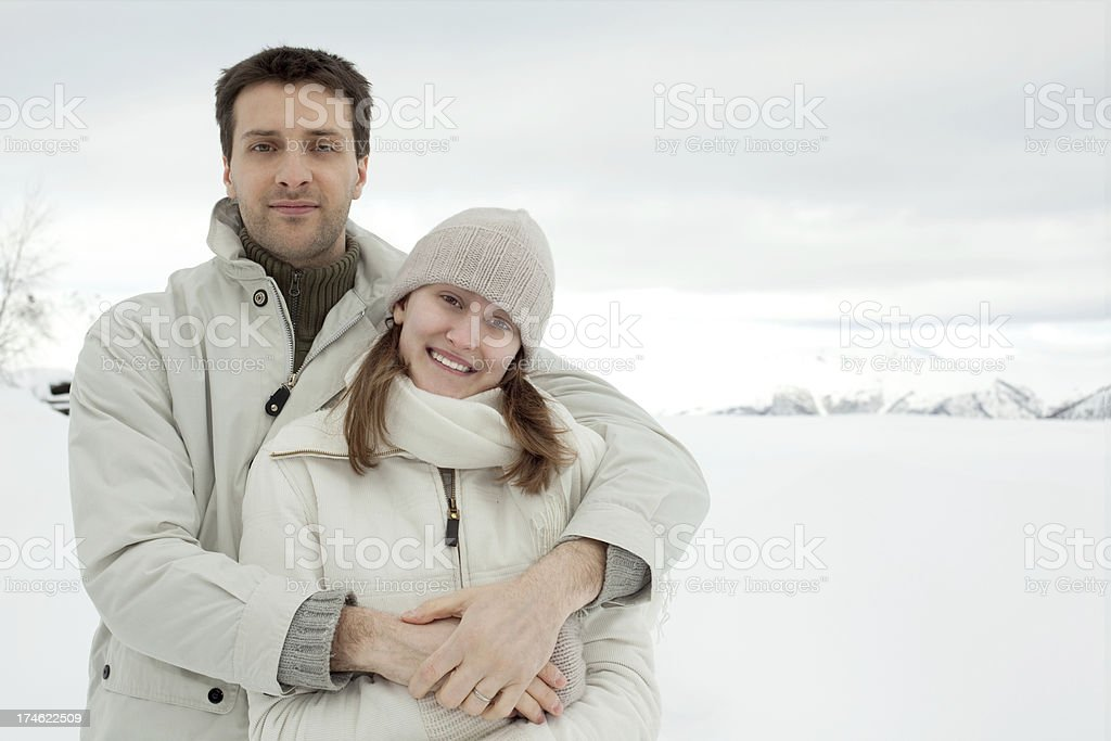 young beautiful couple man girl hug winter portrait with snow stock photo
