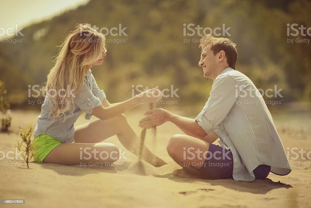 Young beautiful couple on the beach royalty-free stock photo