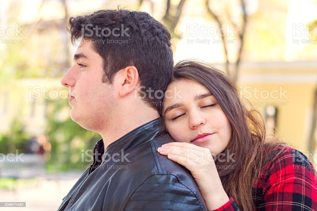 young beautiful couple relaxing outdoors stock photo