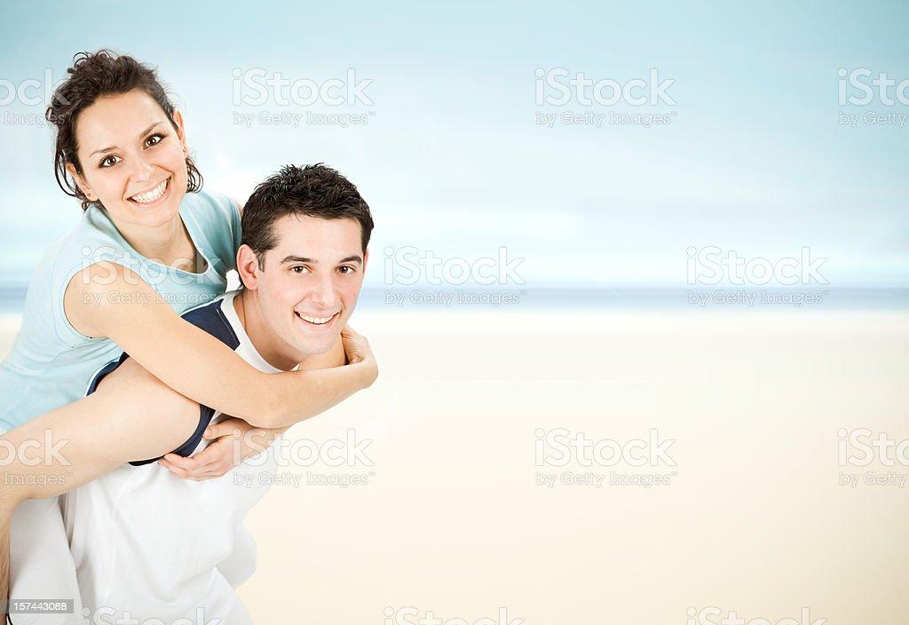 young beautiful couple shouldering at sea shore royalty-free stock photo