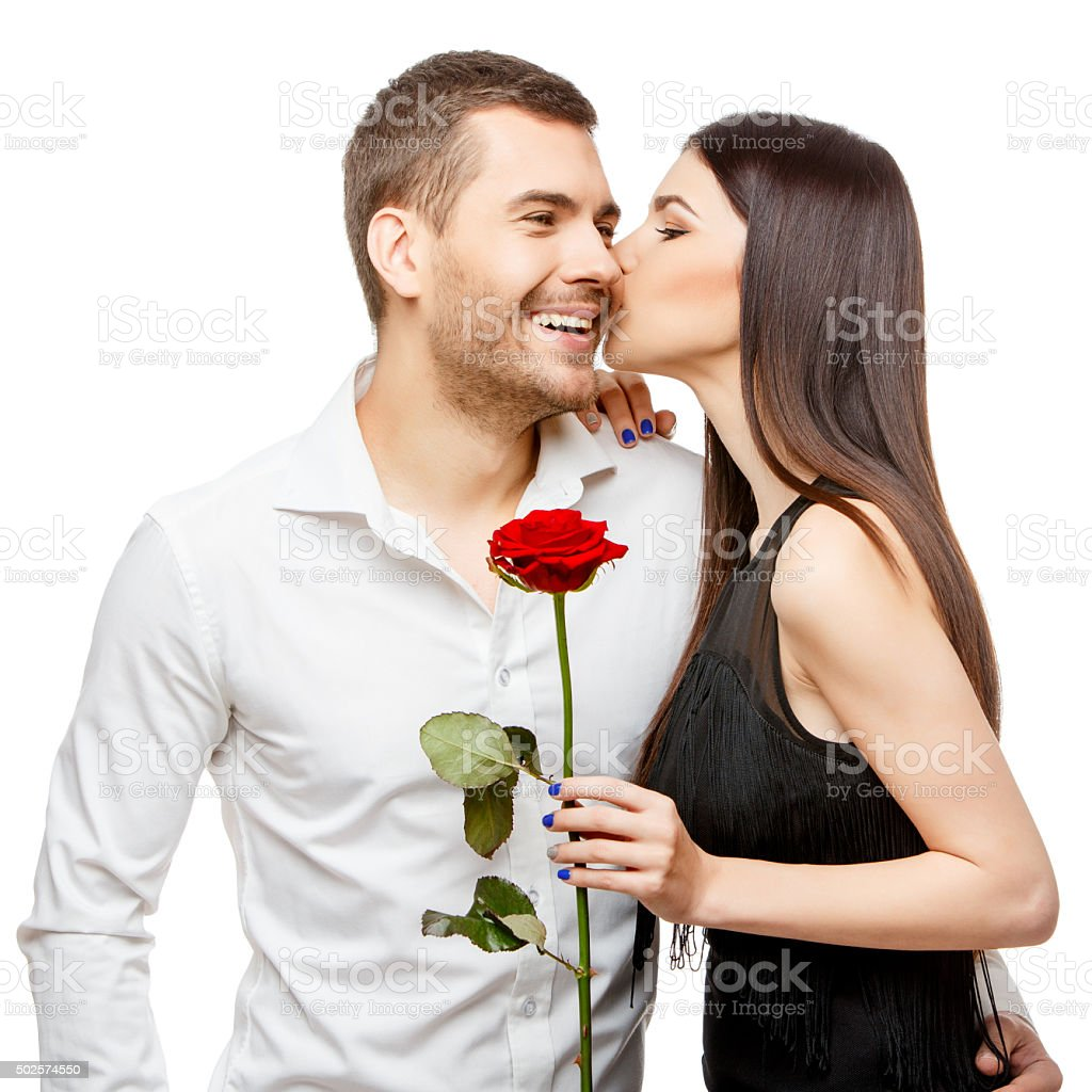 Young beautiful couple with flowers isolated on white stock photo