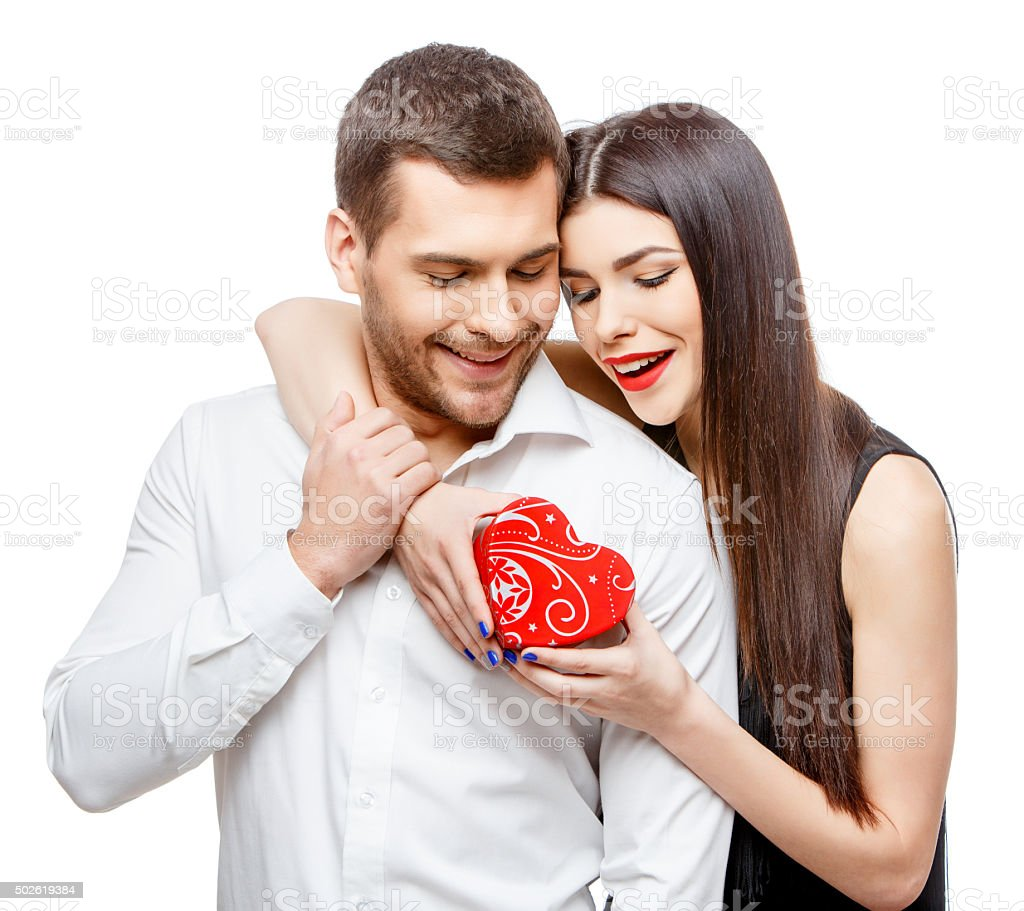 Young beautiful couple with present isolated on white stock photo