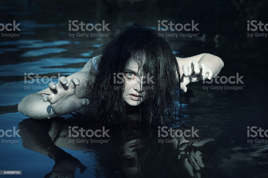 Young beautiful drowned ghost woman in the water stock photo