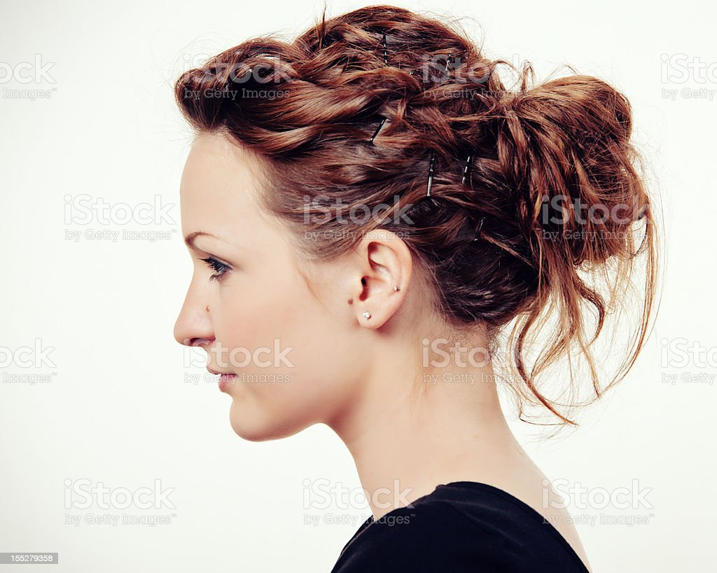 Young, Beautiful Fashion Model Profile with Hair Bun stock photo