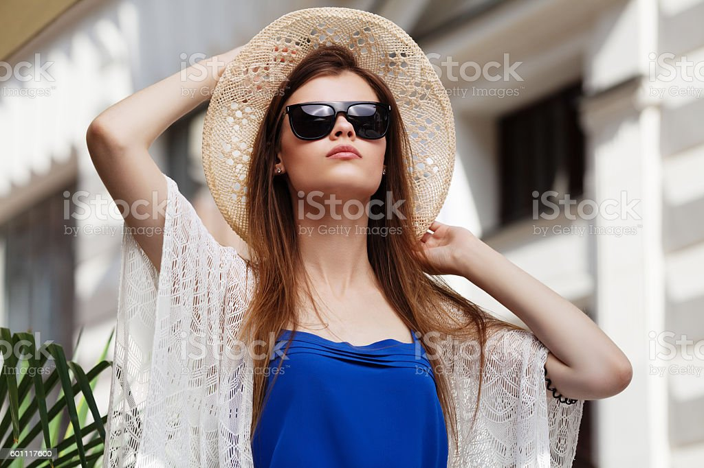 Young beautiful fashionable lady posing on a street. Model wearing stock photo