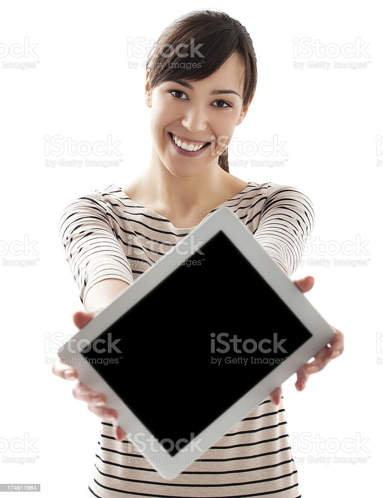 Young beautiful female holding and showing tablet royalty-free stock photo