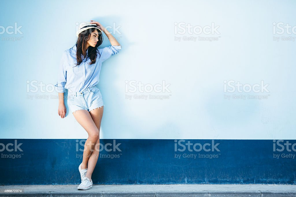 Young beautiful female standing stock photo