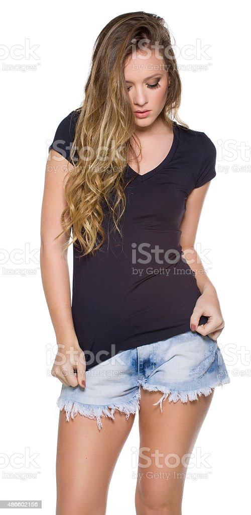 Young beautiful female with blank white shirt stock photo
