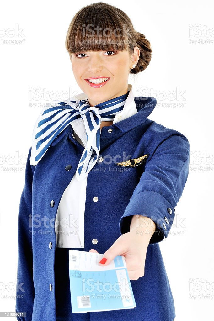 Young beautiful flight attendant giving a ticket royalty-free stock photo