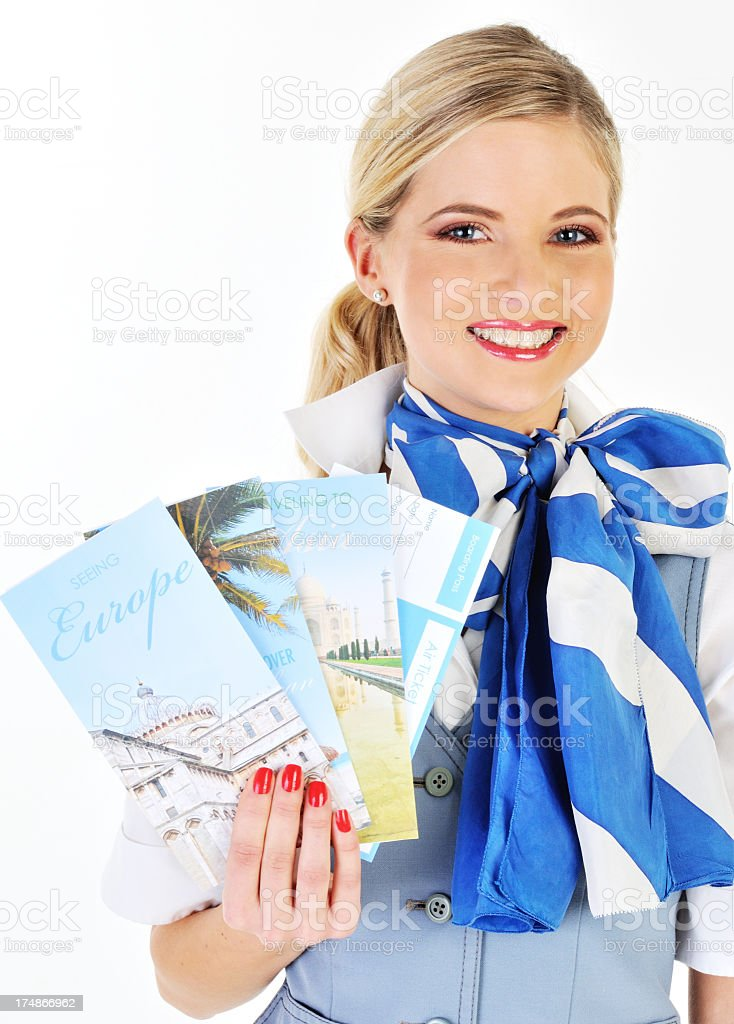 Young beautiful flight attendant showing catalogs royalty-free stock photo