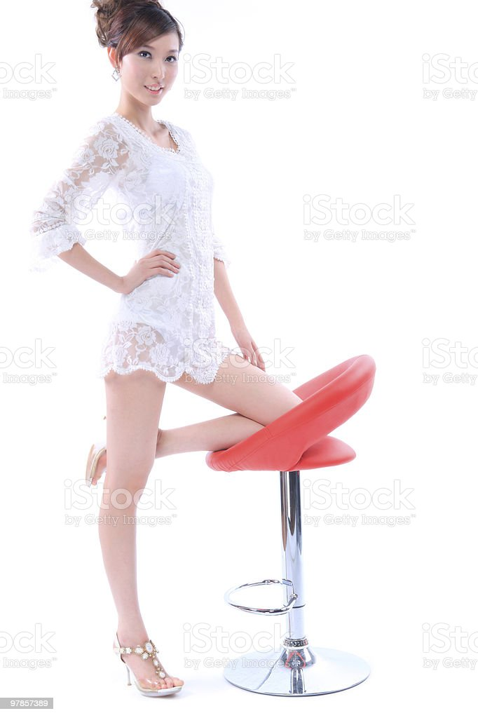young beautiful girl and chair stock photo