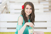 Young beautiful girl enjoying lemonade in cafe