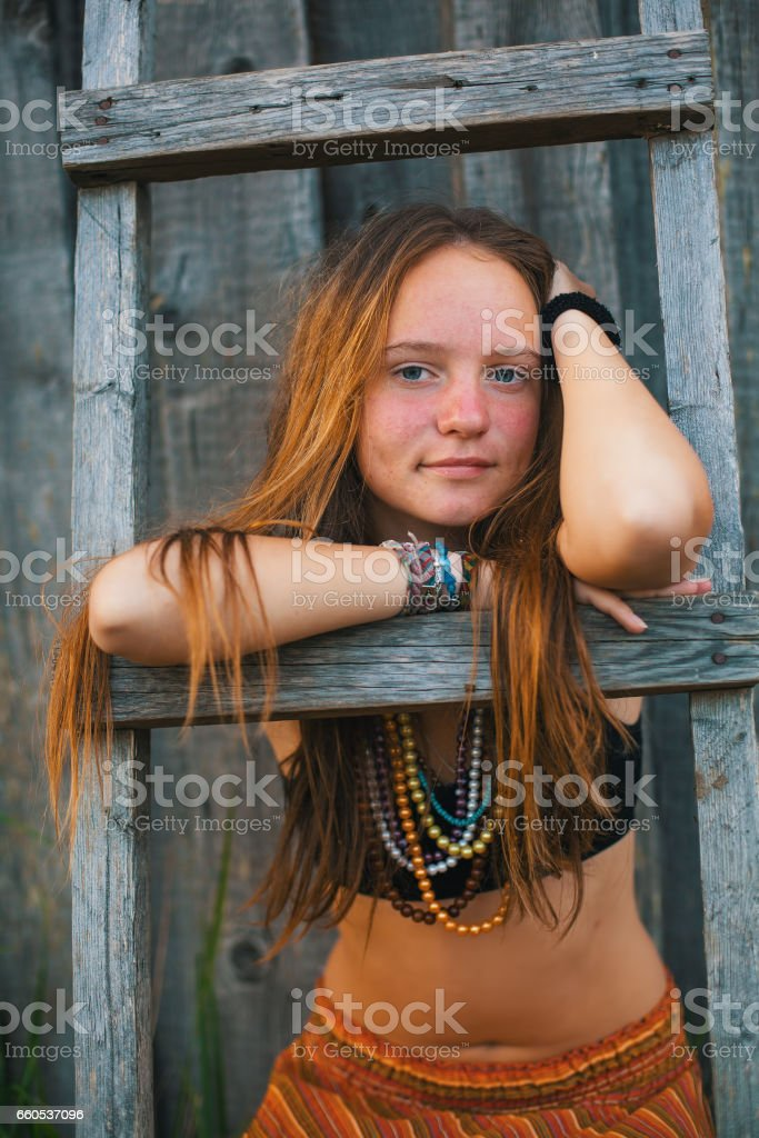 Young beautiful girl in the village. Hippie. stock photo
