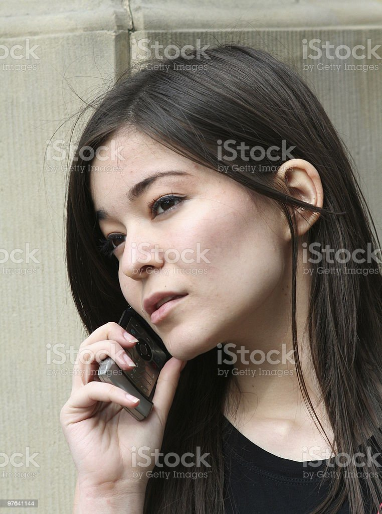 young beautiful girl is calling royalty-free stock photo