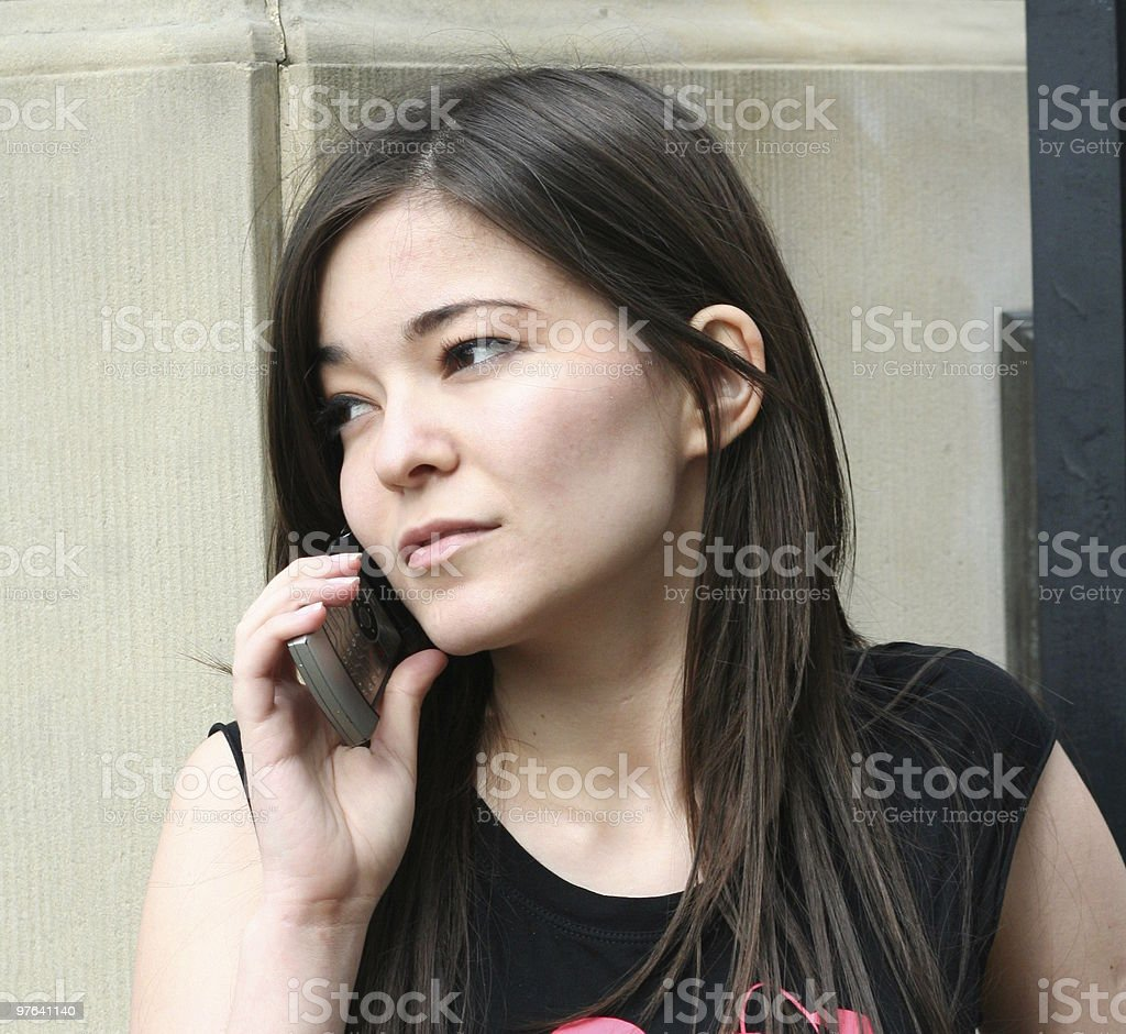 young beautiful girl is calling with people royalty-free stock photo