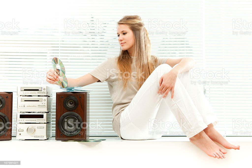Young beautiful girl listen music royalty-free stock photo