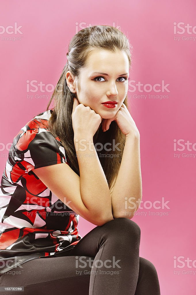 Young beautiful girl sits on chair royalty-free stock photo