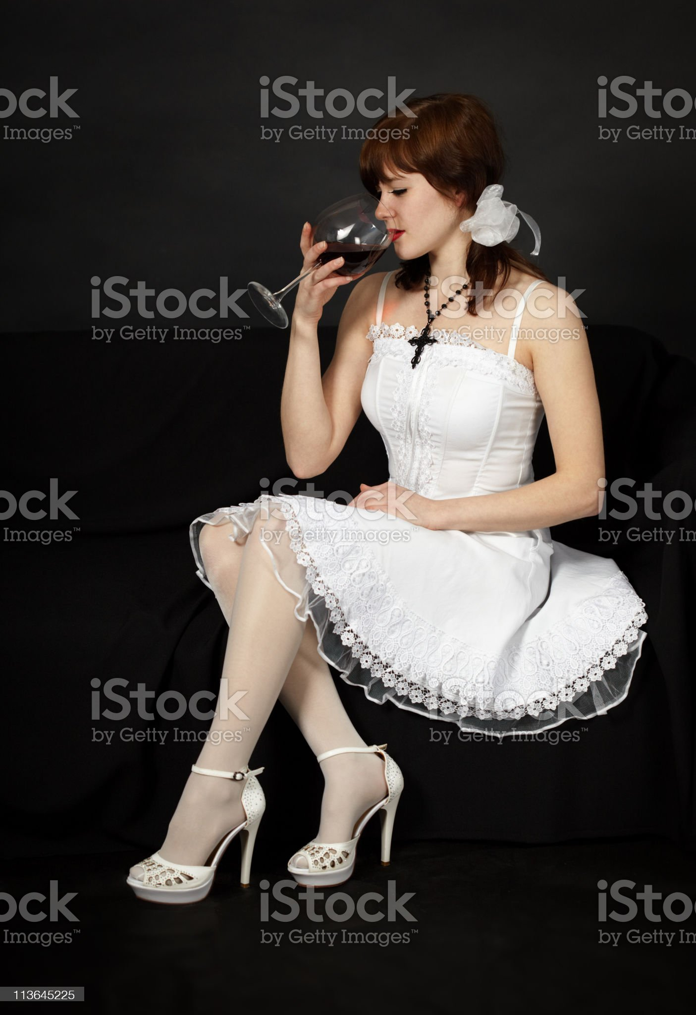 Young beautiful girl sits with a glass royalty-free stock photo