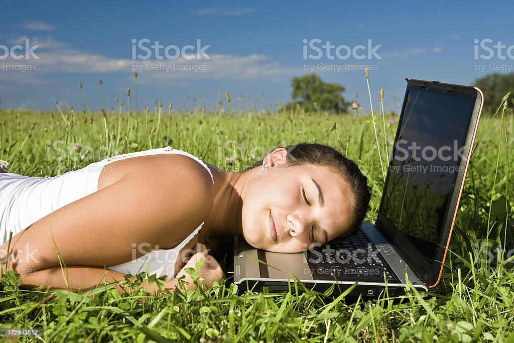 young beautiful girl sleep on laptop outdoor royalty-free stock photo