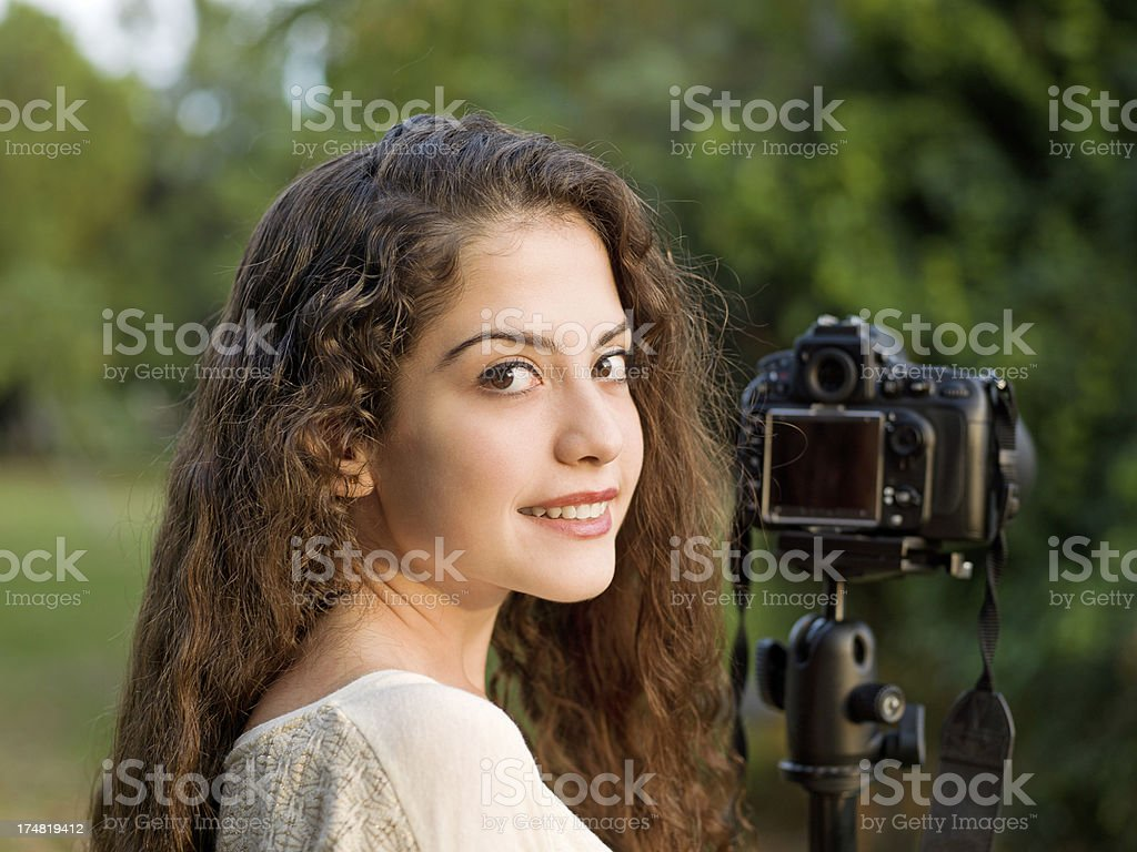 Young beautiful girl taking pictures royalty-free stock photo