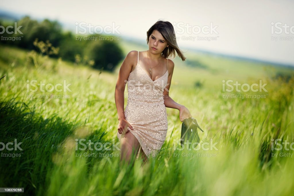 Young beautiful girl walk on grass royalty-free stock photo