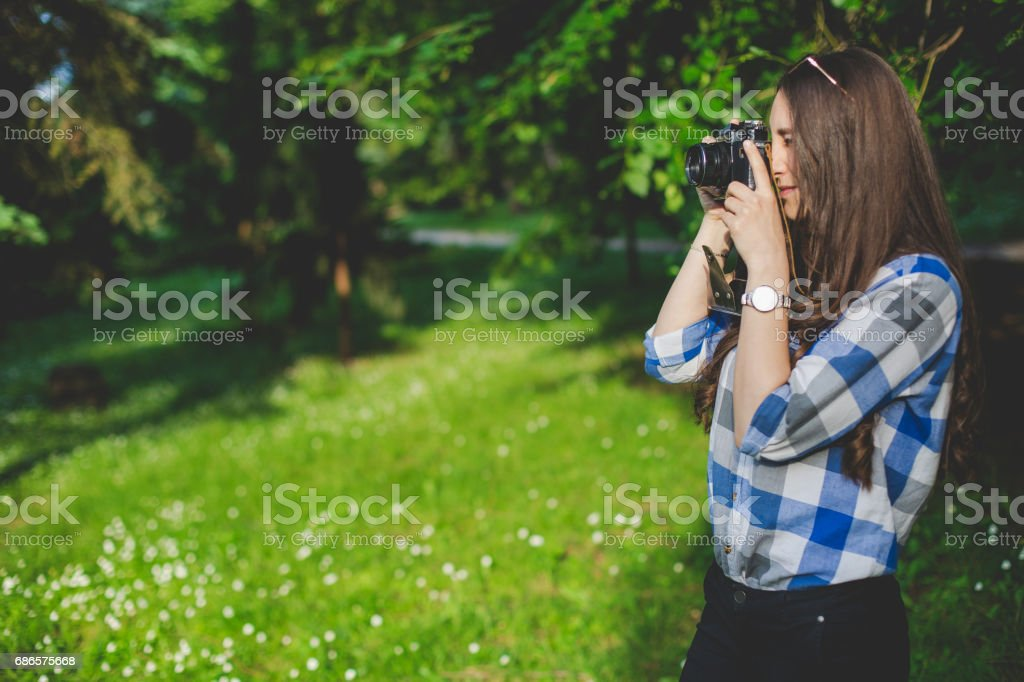 Young beautiful girl with camera stock photo