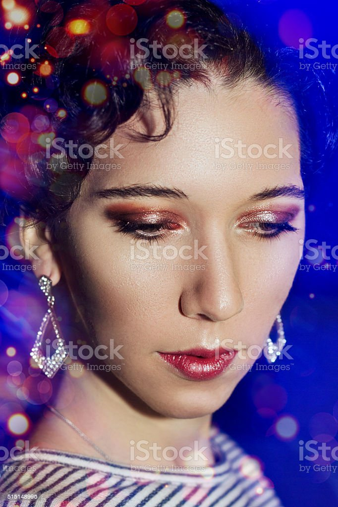 Young beautiful girl with make-up stock photo