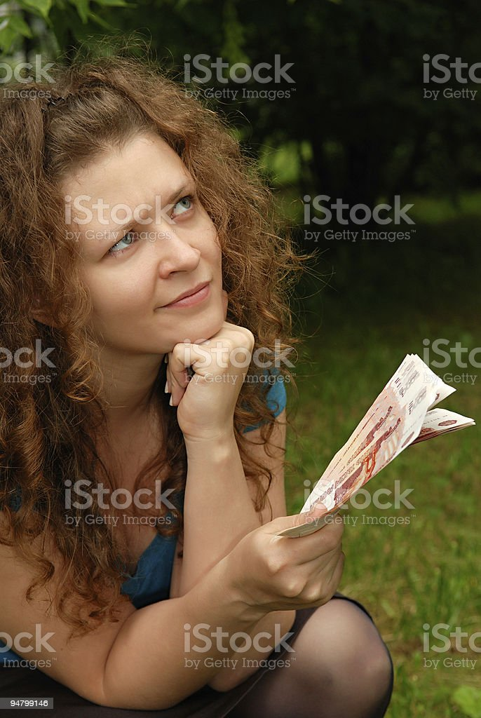 Young beautiful girl with money royalty-free stock photo