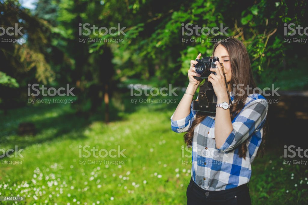 Young beautiful girl with old camera stock photo