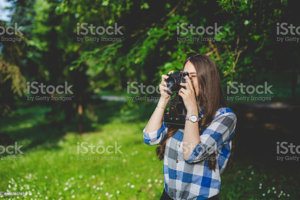 Young beautiful girl with retro camera stock photo