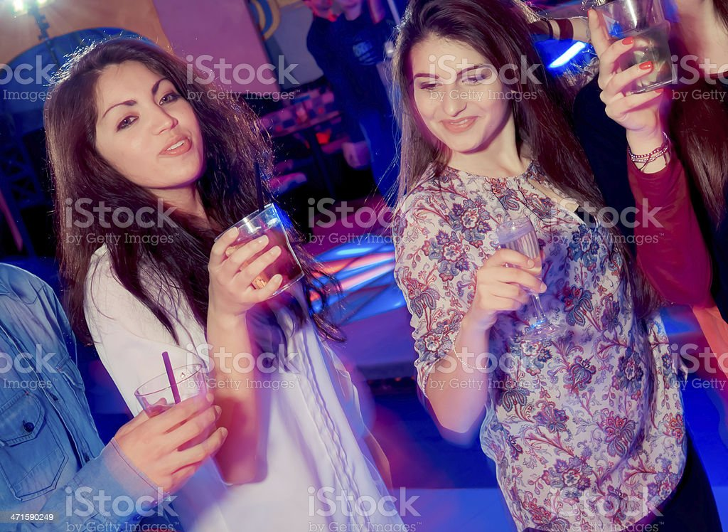 Young beautiful girls dancing at the Party royalty-free stock photo