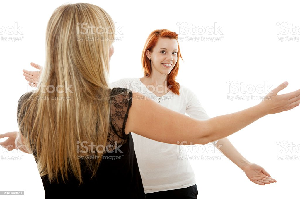 young beautiful  girls happy to see again stock photo