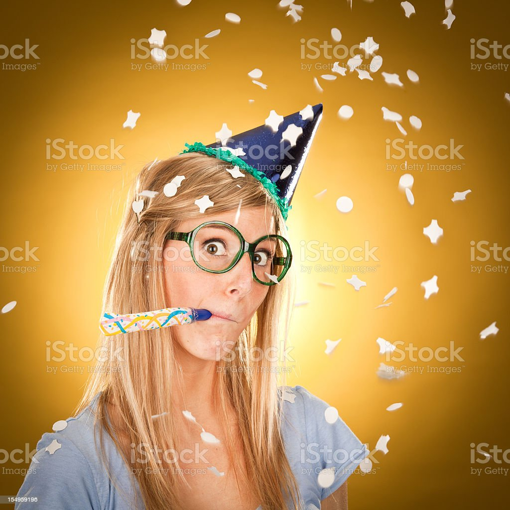 young beautiful happy blonde girl at party with confetti royalty-free stock photo