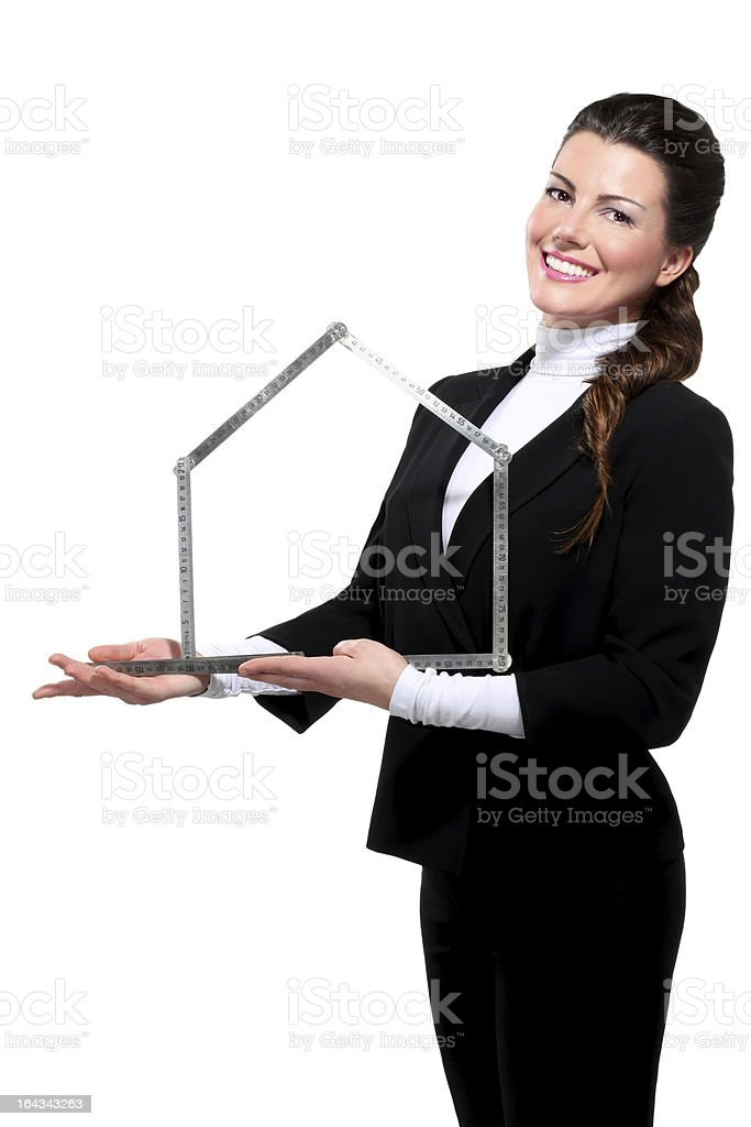 Young beautiful happy business woman house symbol royalty-free stock photo
