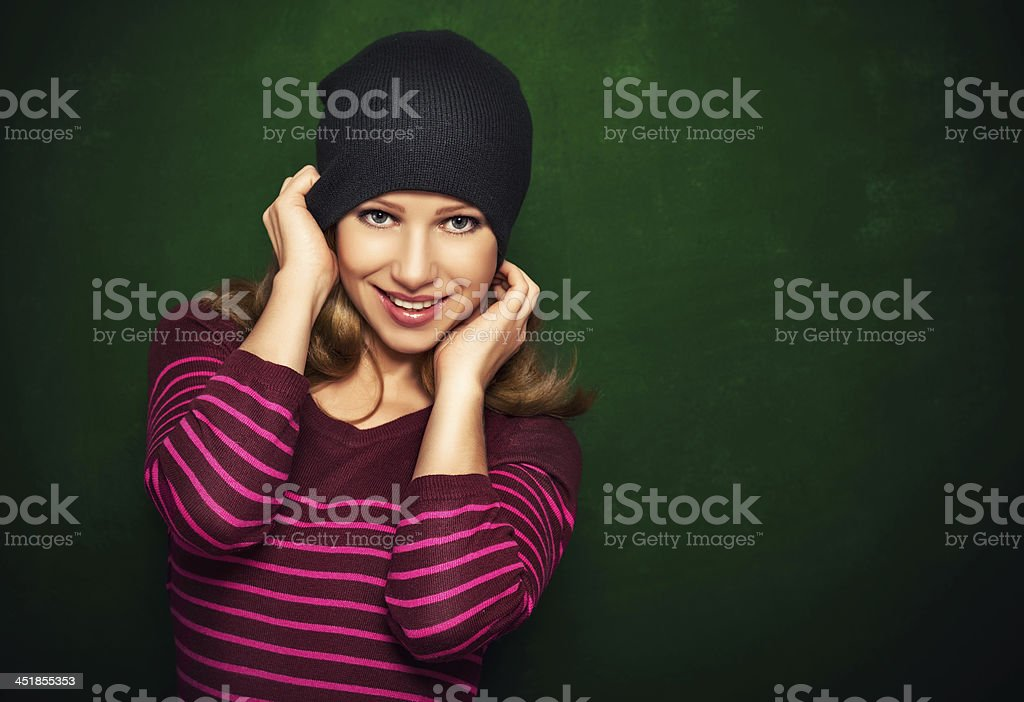 Young beautiful happy girl teenager in  black on green backgr royalty-free stock photo