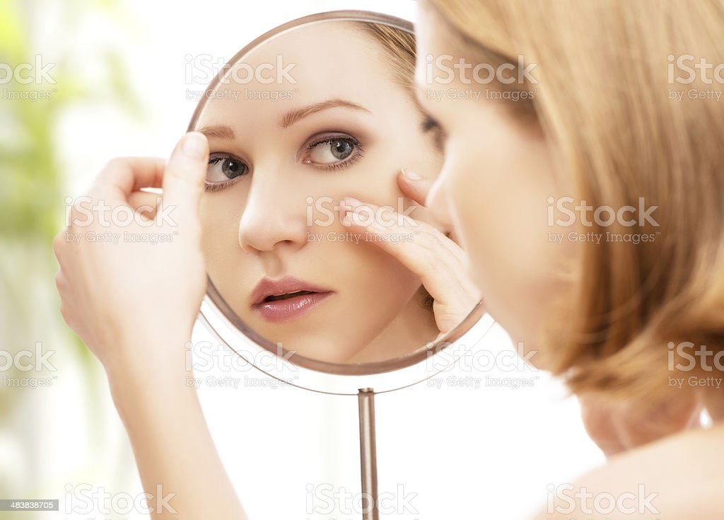 young beautiful healthy woman and reflection in the mirror royalty-free stock photo