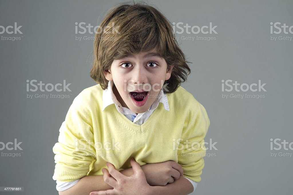 young beautiful kid with shocking painful expression royalty-free stock photo