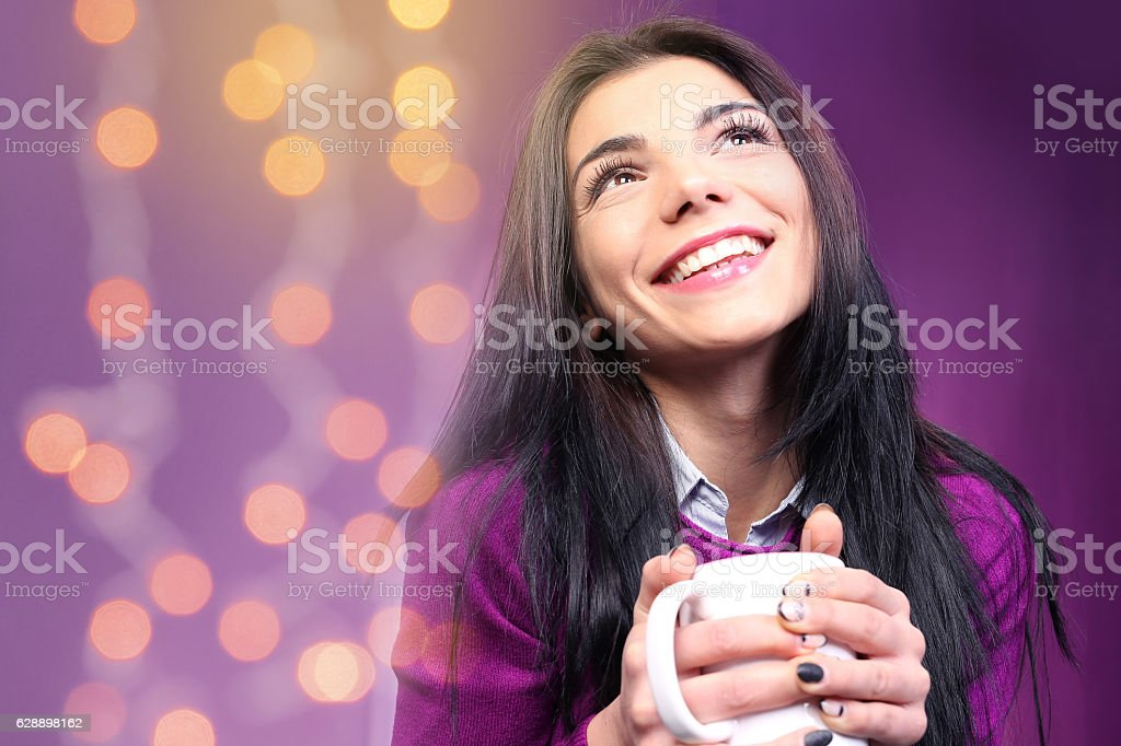 Young beautiful lady holding tea cup stock photo