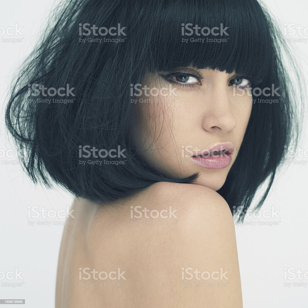 Young beautiful lady looking over her shoulder at the camera royalty-free stock photo