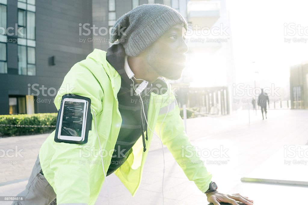 Young Beautiful Man Exercising Outdoors In The Early Morning stock photo