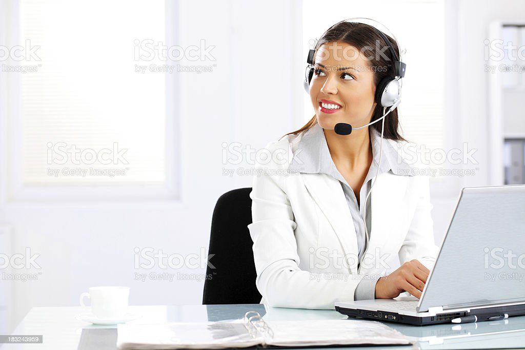Young beautiful operator with headphones in office. royalty-free stock photo