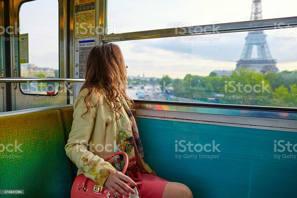 Young beautiful Parisian woman in subway stock photo