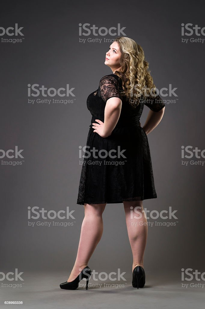 Young beautiful plus size model in black dres, xxl woman stock photo