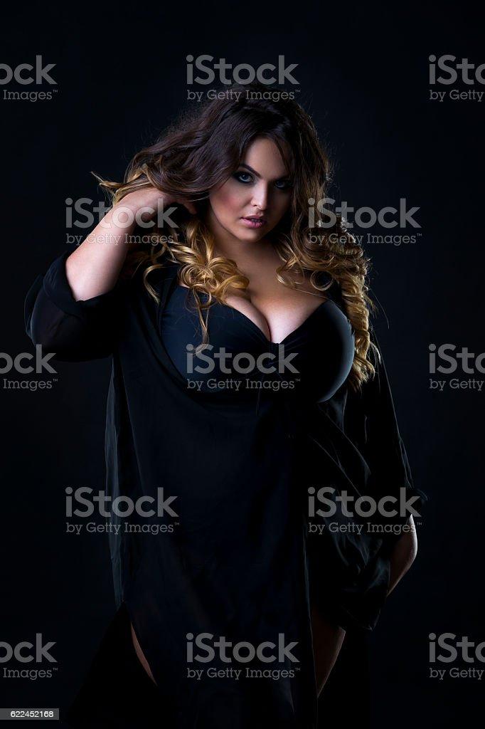 Young beautiful plus size model in underwear, xxl woman stock photo