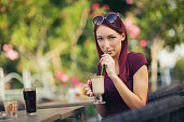 Young beautiful red hair woman drinking coffee