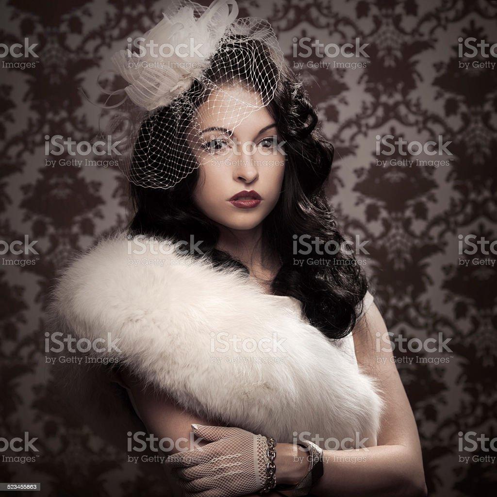 Young beautiful retro lady stock photo
