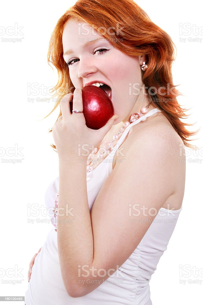 young beautiful sexy red eating apple woman royalty-free stock photo