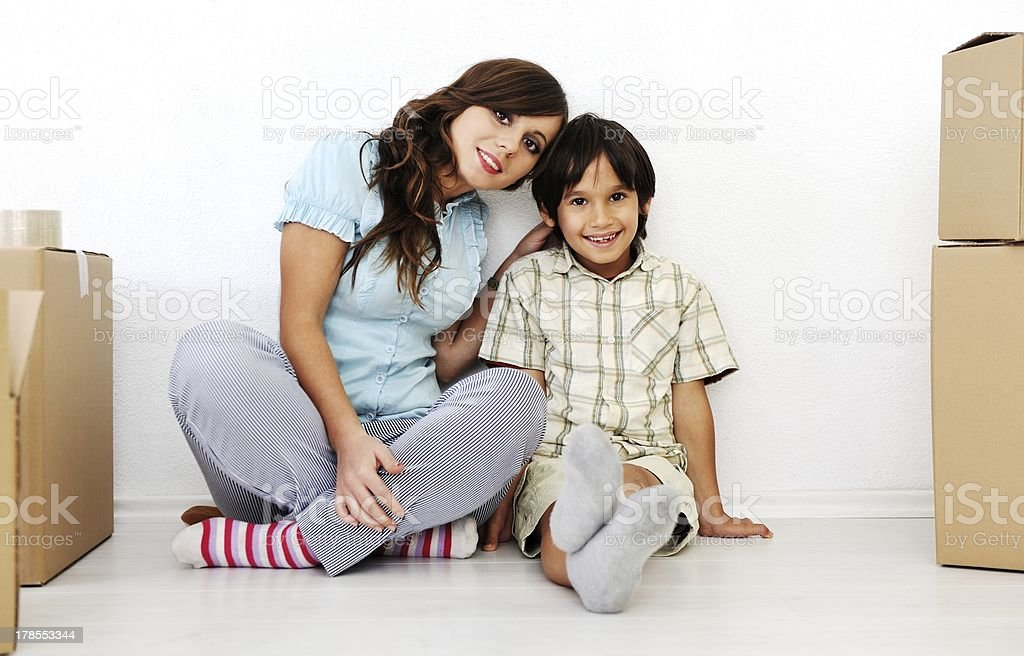 Young beautiful smiling woman and little boy sitting alogside ca royalty-free stock photo
