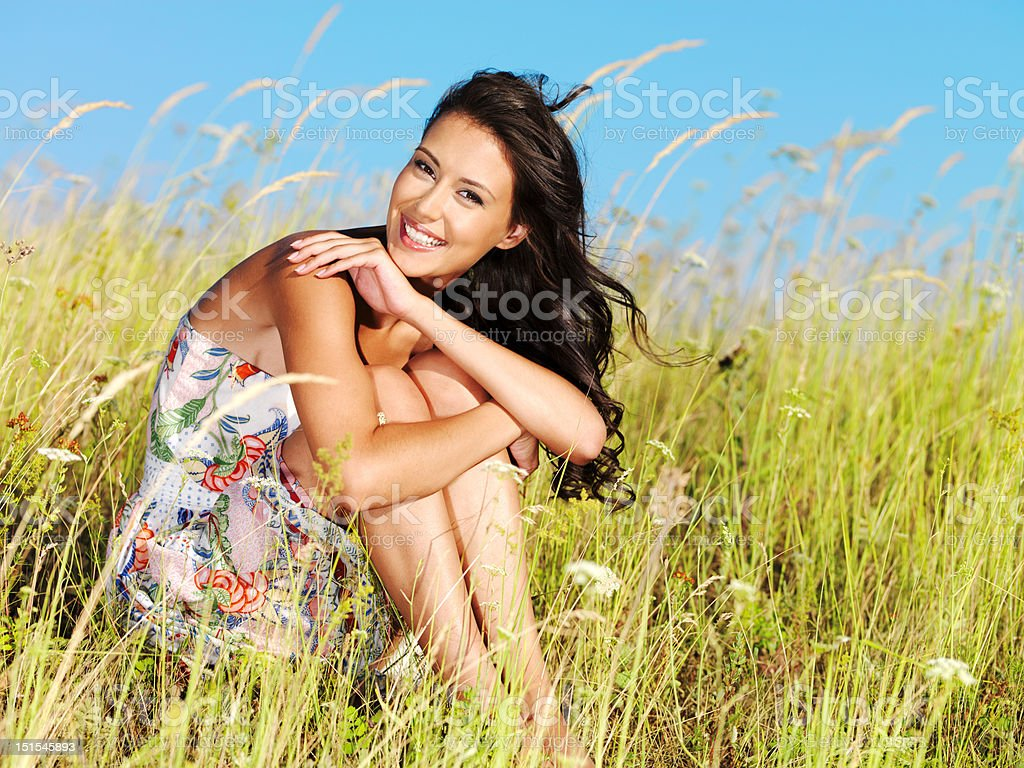 Young beautiful smiling woman outdoors royalty-free stock photo